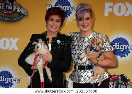 "LOS ANGELES - NOV 22:  Sharon Osbourne, Kelly Osbourne at the FOX's ""Cause for Paws:  All-Star Dog Spectacular"" at the Barker Hanger on November 22, 2014 in Santa Monica, CA"