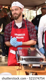 LOS ANGELES - NOV 23:  Tom Payne arrives to the Los Angeles Mission Thanksgiving Meal for the Homeless  on November 23, 2016 in Los Angeles, CA