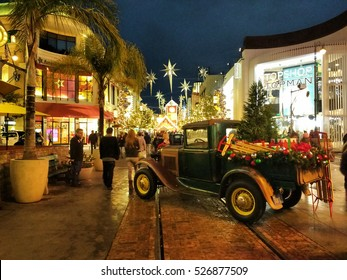 LOS ANGELES, NOV 26TH, 2016: A classic green pick up truck sporting Christmas decorations at the historic Farmers' Market and Grove shopping center in the Fairfax district of Los Angeles.