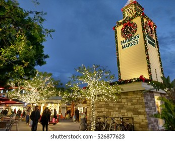 LOS ANGELES, NOV 26TH, 2016: The historic clock tower at the Farmers' Market at the Grove, decorated with a Christmas wreath, in the early evening hours during the holidays.
