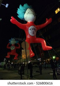 """LOS ANGELES, NOV 27TH, 2016: A """"Thing 1"""" comic figure from Dr. Seuss floats above a side street near Hollywood Boulevard during preparations for the 85th annual Hollywood Christmas Parade."""