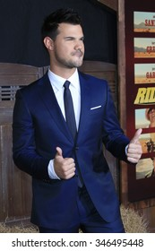 """LOS ANGELES - NOV 30:  Taylor Lautner at the """"The Ridiculous 6"""" Premeire Screening at the AMC Theaters at CityWalk on November 30, 2015in Los Angeles, CA"""