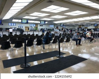 LOS ANGELES, NOV 3rd, 2018: People are sitting on rows of chairs while waiting inside the DMV field office in Culver City, California.