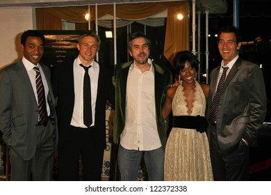 """LOS ANGELES - NOVEMBER 16: Chiwetel Ejiofor, Charlie Hunnam, Alfonso Cuaron, Clare-Hope Ashitey and Clive Owen at the Los Angeles Premiere of """"Children Of Men"""" at on November 16, 2006 in Westwood, CA."""