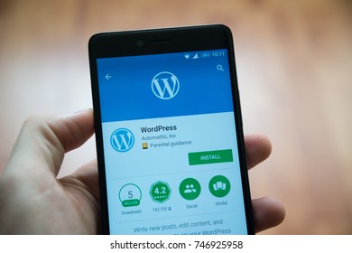 Los Angeles, november 2, 2017: Man hand holding smartphone with Wordpress application in google play store