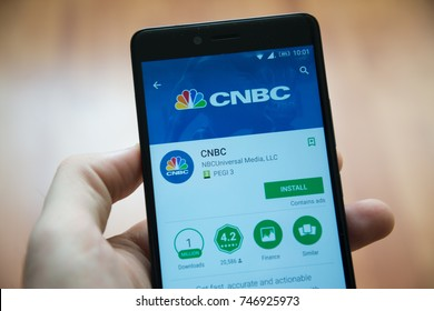 Los Angeles, november 2, 2017: Man hand holding smartphone with CNBC application in google play store