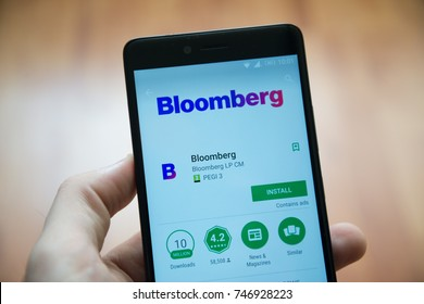 Los Angeles, november 2, 2017: Man hand holding smartphone with Bloomberg application in google play store