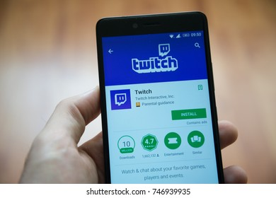 Los Angeles, november 2, 2017: Man hand holding smartphone with Twitch application in google play store
