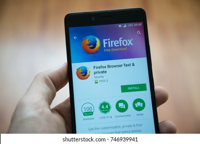 Los Angeles, november 2, 2017: Man hand holding smartphone with Mozilla firefox application in google play store