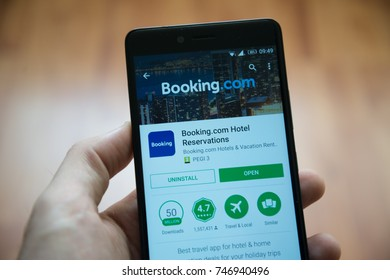 Los Angeles, november 2, 2017: Man hand holding smartphone with Booking.com application in google play store