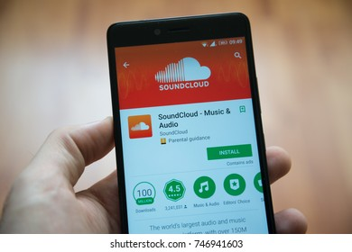 Los Angeles, november 2, 2017: Man hand holding smartphone with Soundcloud application in google play store