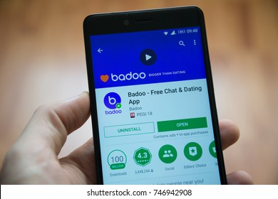 Los Angeles, november 2, 2017: Man hand holding smartphone with Badoo application in google play store