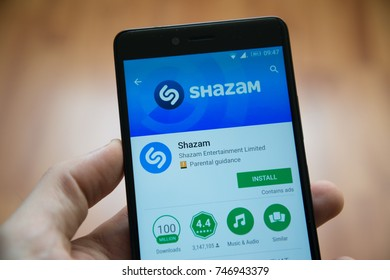 Los Angeles, november 2, 2017: Man hand holding smartphone with Shazam application in google play store