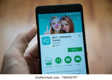 Los Angeles, november 2, 2017: Man hand holding smartphone with B612 Selfiegenic camera application in google play store