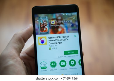 Los Angeles, november 2, 2017: Man hand holding smartphone with Camera 360 - Diwali application in google play store