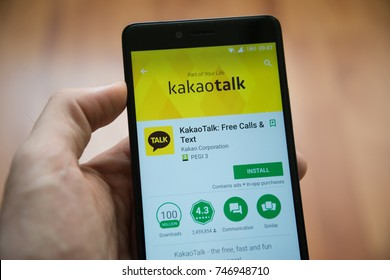 Los Angeles, november 2, 2017: Man hand holding smartphone with Kakaotalk application in google play store