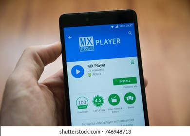 Los Angeles, november 2, 2017: Man hand holding smartphone with MX player application in google play store
