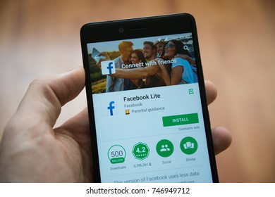 Los Angeles, november 2, 2017: Man hand holding smartphone with Facebook lite application in google play store
