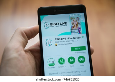 Los Angeles, november 2, 2017: Man hand holding smartphone with Bigo live application in google play store