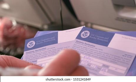 LOS ANGELES - NOVEMBER 2018: Filling US customs declaration form 6059b on flight
