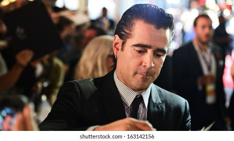 LOS ANGELES - NOVEMBER 8: The actor Colin Farrell signs an autograph for a fan November 8, 2013 in Los Angeles, CA.