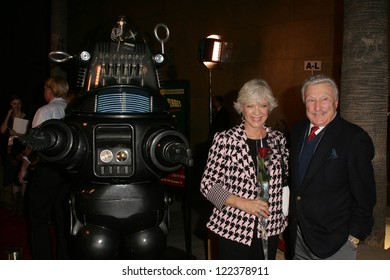 """LOS ANGELES - NOVEMBER 8: Robby The Robot with Anne Francis and Warren Stevens at the 50th Anniversary Gala Screening of """"Forbidden Planet"""" at Egyptian Theatre on November 8, 2006 in Hollywood, CA."""