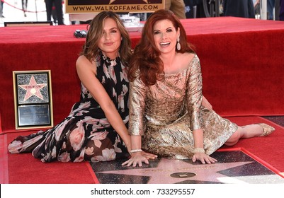 LOS ANGELES - OCT 06:  Debra Messing and Mariska Hargitay arrives for the Debra Messing Hollywood Walk of Fame Star Ceremony on October 6, 2017 in Hollywood, CA
