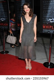 "LOS ANGELES - OCT 06:  Melissa Benoist arrives to the ""Whiplash"" Los Angeles Premiere on October 6, 2014 in Los Angeles, CA"