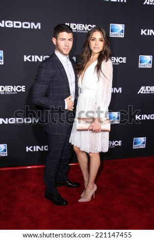 "LOS ANGELES - OCT 1:  Nick Jonas, Olivia Culpo at the ""Kingdom"" Premiere at Muscle Beach on October 1, 2014 in Venice, CA"