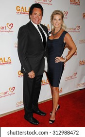 LOS ANGELES - OCT 17:  Wayne Newton and wife Kathleen arrives at the CoachArt 2013 Gala of Champions  on October 17, 2013 in Beverly Hills, CA