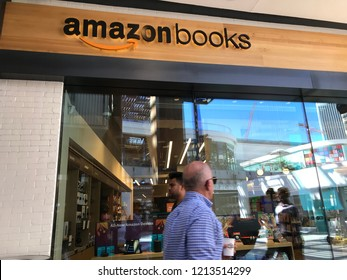 LOS ANGELES, OCT 17TH, 2018: Blurry outline of shoppers walking past the Amazon books bookstore storefront at the Westfield Century City shopping mall.
