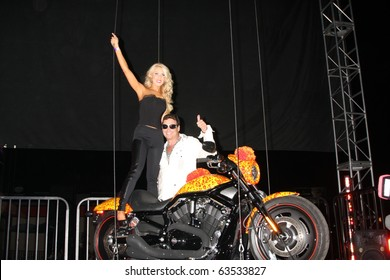 LOS ANGELES - OCT 21:  Gretchen Rossi, Artist Jack Armstrong & Unveiling of Cosmic Harley by Artist Jack Armstrong at Bartels' Harley-Davidson on October 21, 2010 in Marina Del Rey, CA
