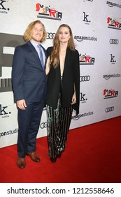 """LOS ANGELES - OCT 24:  Lou Taylor Pucci, Camille Kane at the """"Suspiria"""" Premiere at the ArcLight Theaters on October 24, 2018 in Los Angeles, CA"""