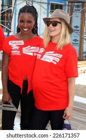 """LOS ANGELES - OCT 25:  Shanola Hampton, Kristen Bell at the Habitat for Humanity build by Showtime's """"House of Lies"""" and Shameless at Magnolia Blvd on October 25, 2014 in Lynwood, CA"""
