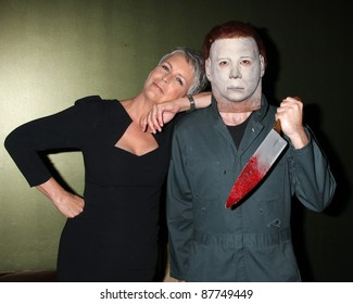 "LOS ANGELES - OCT 30:  Jamie Lee Curtis & ""Michael Myers"" Costumed Guest at the sCare Foundation  Benefit at Conga Room - LA Live on October 30, 2011 in Los Angeles, CA"