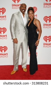 LOS ANGELES - OCT 4:  Steve Harvey and wife Marjorie arrives at the iHeartRadio Music Festival   on September 20, 2013 in Las Vegas, NV