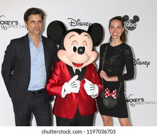 LOS ANGELES - OCT 6:  John Stamos, Mickey Mouse, Caitlin McHugh at the Mickey's 90th Spectacular Taping at the Shrine Auditorium on October 6, 2018 in Los Angeles, CA