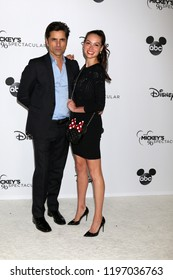 LOS ANGELES - OCT 6:  John Stamos, Caitlin McHugh at the Mickey's 90th Spectacular Taping at the Shrine Auditorium on October 6, 2018 in Los Angeles, CA
