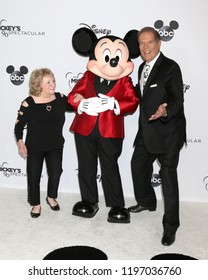 LOS ANGELES - OCT 6:  Sharon Baird, Bob Burgess, Original Mouseketeers, with Mickey Mouse at the Mickey's 90th Spectacular Taping at the Shrine Auditorium on October 6, 2018 in Los Angeles, CA