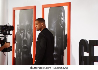 LOS ANGELES, OCT 6th, 2019: Will Smith being photographed next to a poster of his character in Gemini Man, at the premiere of Gemini Man at the TCL Chinese Theatre in Hollywood, California on Oct 6th.