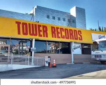 LOS ANGELES, OCT7TH2016:The historic Tower Records building on the Sunset Strip casts a shadow over its parking lot.The store opened in 1971 and closed in 2006,but its outside facade has been restored