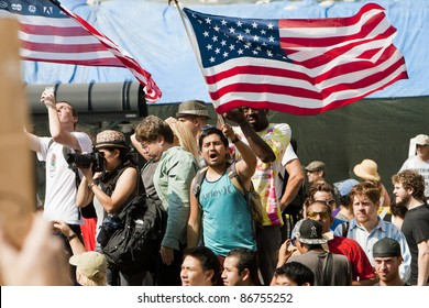 LOS ANGELES - OCTOBER 15: Demonstrators protest at the Occupy LA march through downtown Los Angeles as committed participants wave American flags  on October 15, 2011.