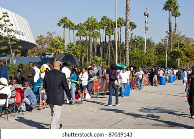 LOS ANGELES - OCTOBER 17: People without medical insurance wait in long lines around the block to see doctors at a free medical clinic at the Sports Arena in Los Angeles, CA on October 17, 2011.