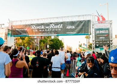 LOS ANGELES - OCTOBER 30: Participants line up at the starting gate at the Rock 'n Roll Marathon at LA Live in Los Angeles on October 30, 2011.