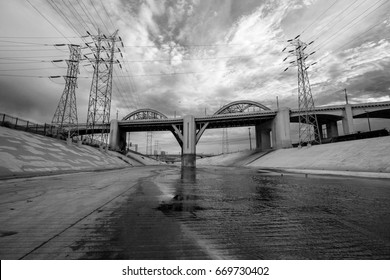 The Los Angeles River and recently demolished 6th Street Bridge near downtown Los Angeles in black and white.