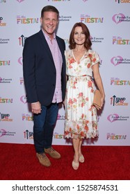 "LOS ANGELES - SEP 06:  Doug Savant and Laura Leighton arrives for the Farrah Fawcett Foundation's ""Tex-Mex Fiesta"" on September 06, 2019 in Beverly Hills, CA"