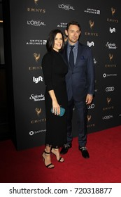 LOS ANGELES - SEP 15:  Neve Campbell, JJ Feild at the Emmy Awards Performers Nominee Reception at the Wallis Annenberg Center for the Performing Arts on September 15, 2017 in Beverly Hills, CA