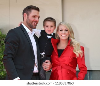 LOS ANGELES - SEP 20:  Mike Fisher, Isaiah Fisher, Carrie Underwood at the Carrie Underwood Star Ceremony on the Hollywood Walk of Fame on September 20, 2018 in Los Angeles, CA