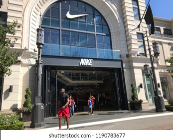 LOS ANGELES, SEP 22, 2018: Customers exit the Nike store at the Grove shopping mall at Third and Fairfax in Los Angeles.