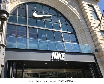 LOS ANGELES, SEP 22, 2018: The Nike sign and logo on the glass facade above the Nike store at the Grove shopping mall at Third and Fairfax in Los Angeles.